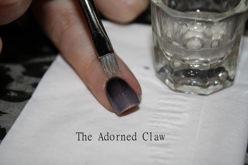 Brush along the cuticle toward the nail tip.