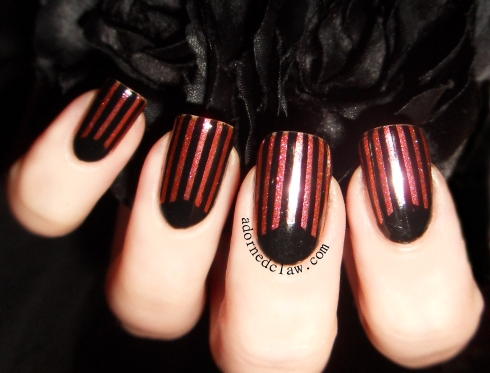 black and glittery half moon nails